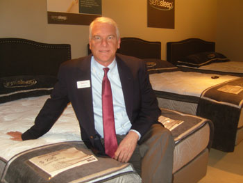 Ashley's Brad Rogers gets comfortable on a new SierraSleep innerspring sleep set.