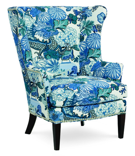 CR Laine's generously proportioned Windsor chair revitalizes a room with lush floral blooms, upholstered in Chiang Mai Indigo from Schumacher. crlaine.com