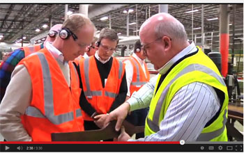 Kevin Sauder, right, of Sauder Woodworking shows a part to Ikea officials in an Ikea promotional video scene shot at Sauder's Ohio plant.