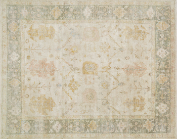 A weeks-long antique washing process imbues this rug from the Vincent Collection with a vintage look, hand-knotted in India of 100% wool.