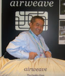 Hajime Kosai of Airweave holds a high-end mattress topper in a carrying case. Airweave is making its first High Point showing.