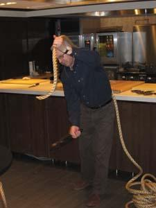 Knife designer Bob Kramer demonstrated the ability of a sharp knife to cut through a thick length of rope.