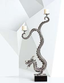 The oversized dragon candelabra is a one-of-a-kind statement piece. natori.com