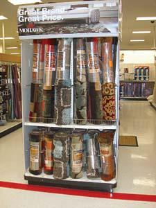 A Mohawk endcap includes a selection of area rugs and runners.