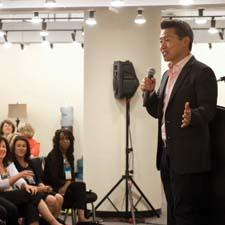 Yip addresses the  crowd at AmericasMart last month.