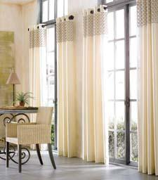 The Gianni collection of tailored window panels has a grommet finish.  softlineonline.com