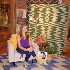 Gorder poses with some of her designs from the new Capel collection at High Point Market.