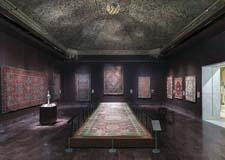 Gallery 459, part of the Koc Family Galleries, includes the Simonetti carpet, center, ca. 1500, over 29 feet in length.