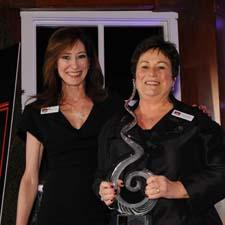 Jenny Hammons receives award from Wendy Tonkin of Western Exhibitors