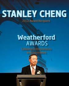 Cheng accepts his award.