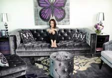 Priscilla Presley relaxing on the sophisticated, yet simple, Ardor sofa.