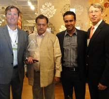 Surya receives the award from Rugs Direct.
