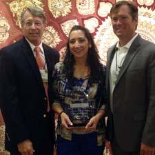 Rugs Direct presents Gina Falsetti with award