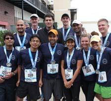 Tiwari and Surya employees at the half-marathon