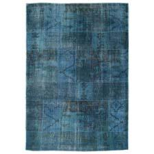 This overdyed patchwork rug, handknotted of wool in India, is sheared down. artresources.us