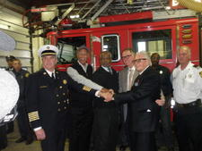 Art Van Elslander with Detroit firefighters