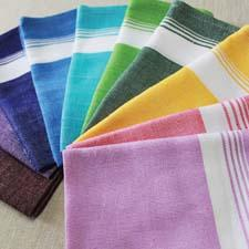 The Full Color line of table linens from Kara Weaves is made with thorthu, a traditional fabric of India. karaweaves.com