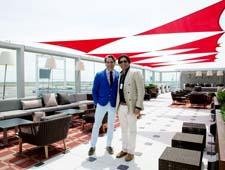 Filicia (left) and Jonathan Yaraghi on The Sky Deck at JFK