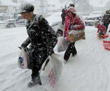 Shoppers In Snow