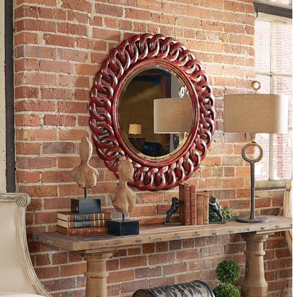 An exclusive design from Matthew Williams, Uttermost's new Sassia mirror features a carved, solid mango wood finished in heavily distressed, aged red with black accents. The mirror has a generous 1.25-inch bevel. uttermost.com