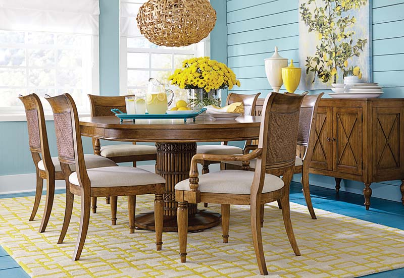 Bassett's Pelham Bay Collection features a warm medium finish on straight grain oak with iconic bamboo details. Pictured is the dining room collection. bassettfurniture.com