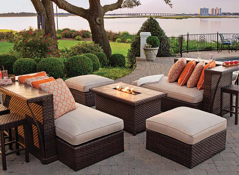 The Kolea All Weather Wicker seating arrangement combines a sectional sofa, bar unit and gas fire pit.  agiousa.com