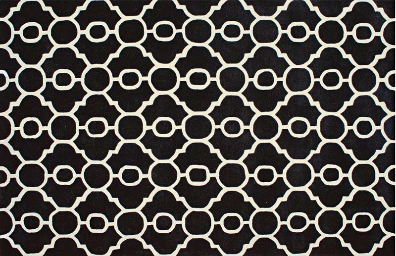 Handtufted in India and with handcarved motifs, Jaunty's wool Newport collection includes this design, NP-58 Black. jauntyinc.com