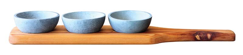 These sleek soapstone bowls complement the trio's cedarwood tray. sparqusa.com