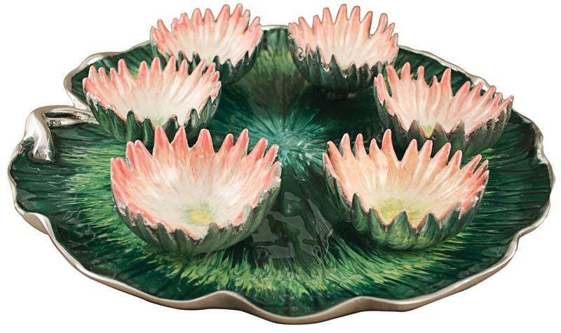 New York City artisans created six pink enamel lotus flowers to sit atop an enameled aluminum lily pad. questcollection.com