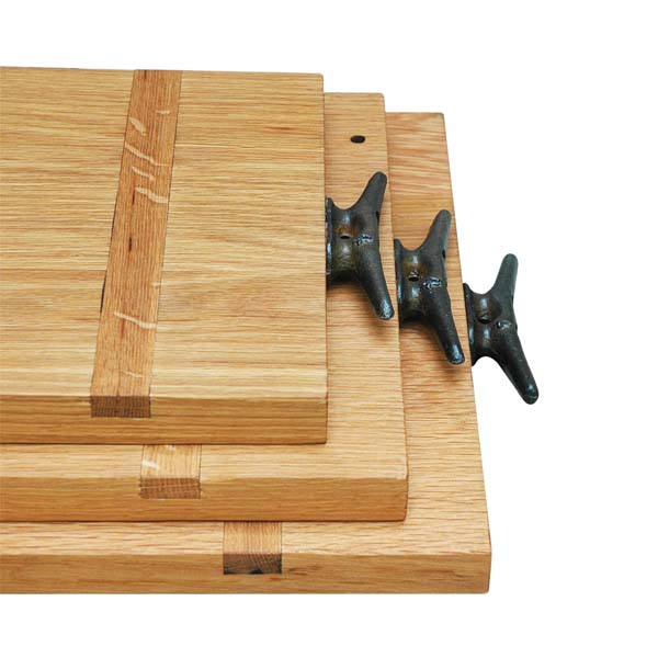 These cut and serving boards are made of reclaimed oak and fitted with aged steel boat cleat handles. pegandawlbuilt.com