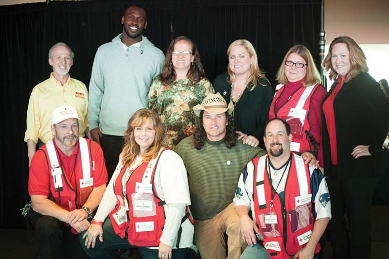 "Bob's Discount Furniture and the American Red Cross teamed up with the New England Patriots to host the seventh annual ""mega"" blood drive and day of family fun at Gillette Stadium. Pictured: Bob's Discount President Bob Kaufman (far left), New England Patriot Chandler Jones (second from left), and Boston Marathon first responders."