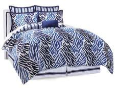 The Animal Print bed ensemble collection (seen here in the navy colorway) includes a comforter, two Euro shams, two standard shams, a bed skirt and a decorative pillow. markhampton.com