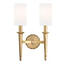 The sleekly tapered, candlestick-bearing torches and cylindrical linen shades of Hudson's Tioga bring modern balance to the design. Available in aged brass, old bronze, polished chrome or polished nickel finishes and as one- or two-light sconces. hudsonvalleylighting.com