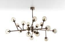 The Dallas chandelier (#89981) takes inspiration from both mid-century design and Sputnick. The 18-light fixture has 12 adjustible arms and is made of iron in an brown nickel finish. arteriorshome.com