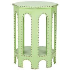Safavieh's Lacey Side Table is covered with light green polyurethane leather with chrome nailhead detailing. safavieh.com