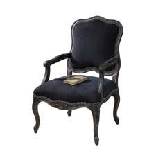 Uttermost's Thetis armchair is handcarved and handfinished in an ash gray wash over natural wood grain. uttermost.com