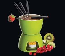 Available in red, brown, orange and green, the Cilio by Frieling Chocolate Fondue Set is a two-cup set made of porcelain. The pot rests on a porcelain base that houses a tea light. Four color-coded forks included. frieling.com