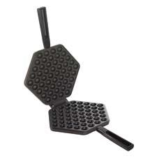 "Made to create a classic street snack that is often found in Hong Kong, the Nordic Ware Egg Waffle Pan creates a thin waffle featuring individual ""eggs"" that can be pulled apart as a snack or filled for eating. nordicware.com"