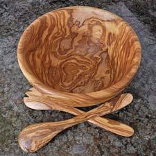 This rustic edge olivewood bowl features a unique wood grain structure that highlights the artistic work of the company's artisans. naturalolivewood.com