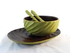 These spiral-carved reclaimed mango tabletop pieces are available in avocado, chili pepper and tangerine and include a salad bowl, platter and salad servers. enricoproducts.com