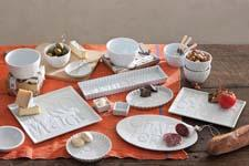 A delicious combination of food and design, Savour features debossed vintage type on white porcelain. rosannainc.com