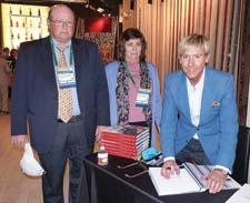 "Designer Barclay Butera, right, signs his book ""Living on the Coast,"" while Steve and Nancy Steinhardt from At Home in the Valley look on in the Nourison showroom. Proceeds from the sale of the book at the event, along with a matching contribution from Nourison, will be donated to the Hurricane Sandy NJ Relief Fund."