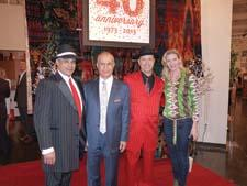 Feizy is celebrating 40 years in business this year, and it kicked off 2013 with a 1940s-themed party. During the party, Bobby Feizy, John Feizy and Cameron Feizy—two of whom dressed in period outfits—posed with designer Tracy Porter.