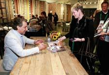 "Attendees lined up at Safavieh during Las Vegas Market to have designer Thom Filicia sign his new book, ""American Beauty:  Renovating and Decorating a Beloved Retreat."""