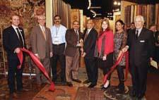 Kas Rugs moved to the first floor of Building B into a bigger space, unveiling its showroom in space B-175, as well as more than 250 introductions. At the ribbon cutting, from left, are IMC's Ryan Mahoney, Kas' Steve Roan, Raja Tummala, Hari Tummala, Rao Yarlagadda, Wendy Reiss and Santhi Yarlagadda and IMC's Ron Radin.