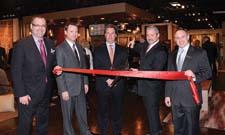 Sphinx by Oriental Weavers debuted its showroom at market, in Building C, C-395. Fifty percent larger than its former location, the new showroom also highlights product from its OW Hospitality division. Flanked by IMC's Boyd Tasker, left, and Lee Hershberg are Oriental Weavers' Jonathan Witt, Andy Brumlow and Mike Riley.