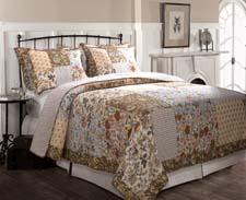 The design of the Camilla bed ensemble is a collage of updated floral and foulard fabrics in both natural and blue colors. greenlandhomefashions.com