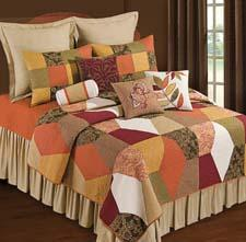 The Avanni bed ensemble features a mixture of patterns in a geometric design and a warm color palette. cnfei.com