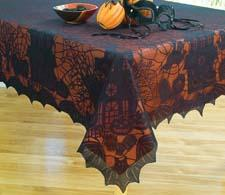 Bewitching Lace is a black tablecloth made of 100 percent polyester, and comes with a 100 percent vinyl orange liner. 212-889-6376
