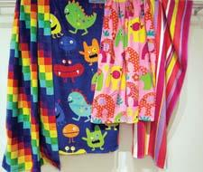 The brightly colored comical monsters in Monster Mash and whimsical elephants in Elefriends are part of the company's new beach-towel offerings. loftex.com